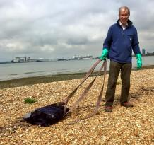 Ian with a section of a settee (we think) that he was able to haul of the beach