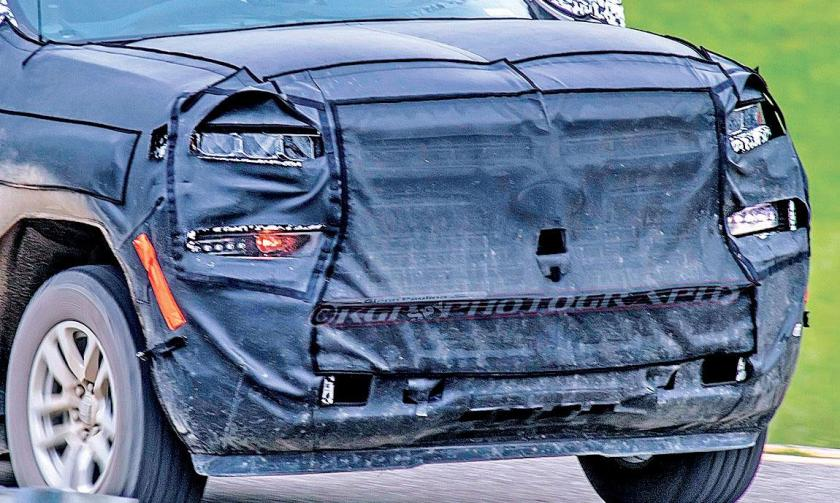 The front end of Chevrolet's redesigned Silverado coming next year looks to have a less rectangular shape than the current generation.