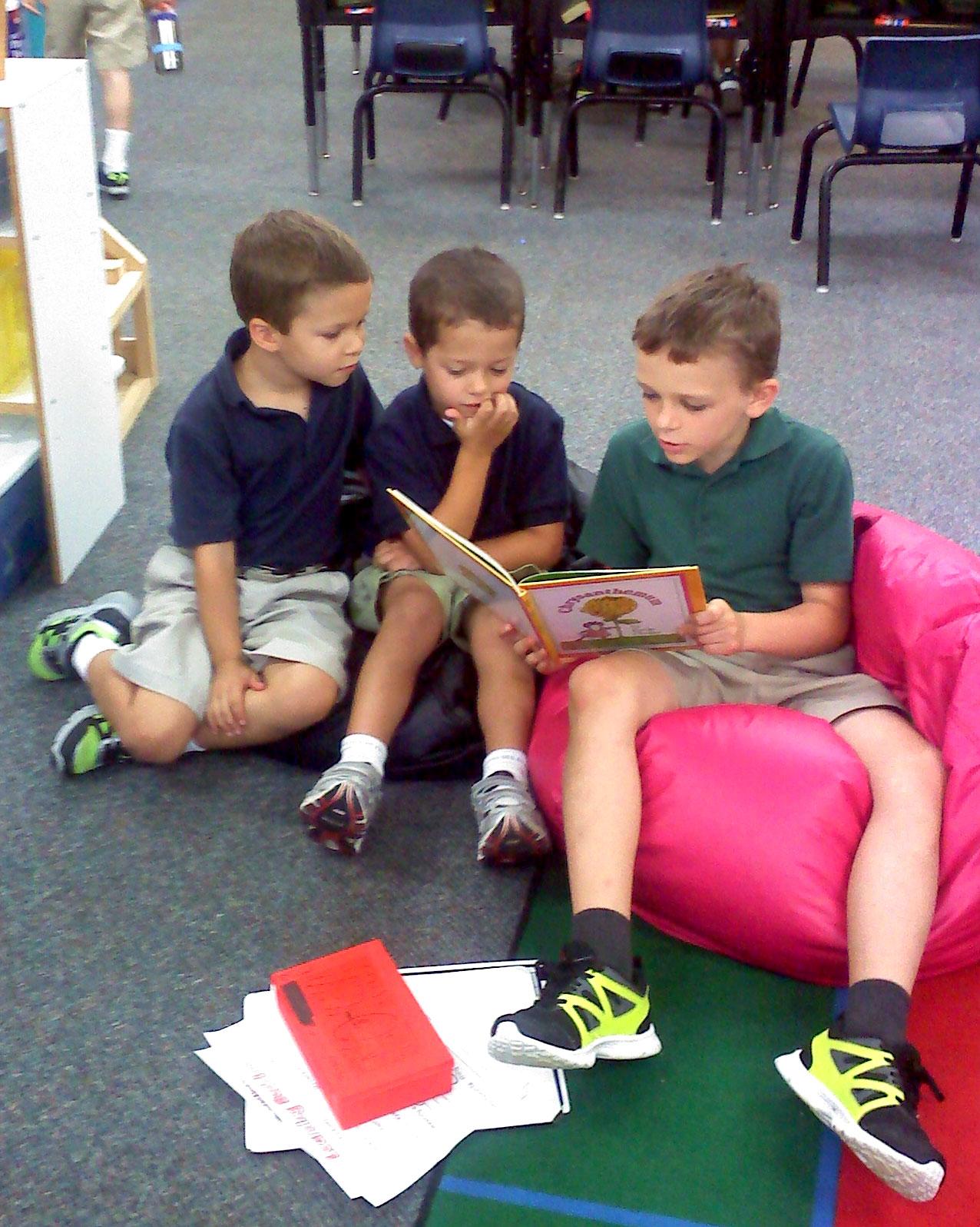 5th grader with his kindergarten reading buddies.