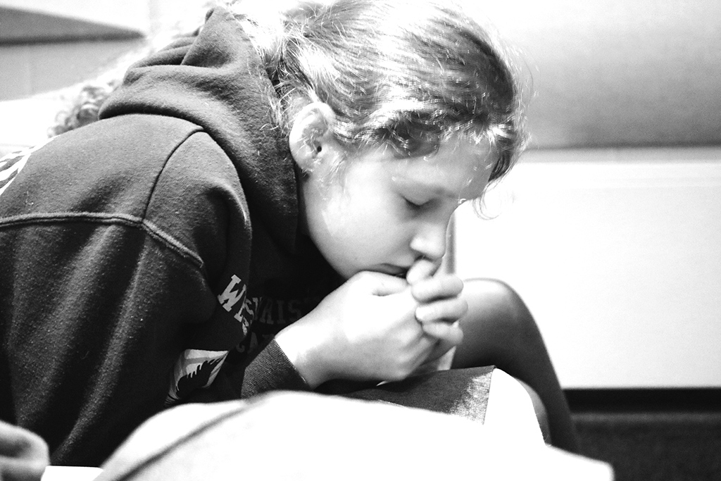 Upper School Student in Prayer at the RZIM Conference