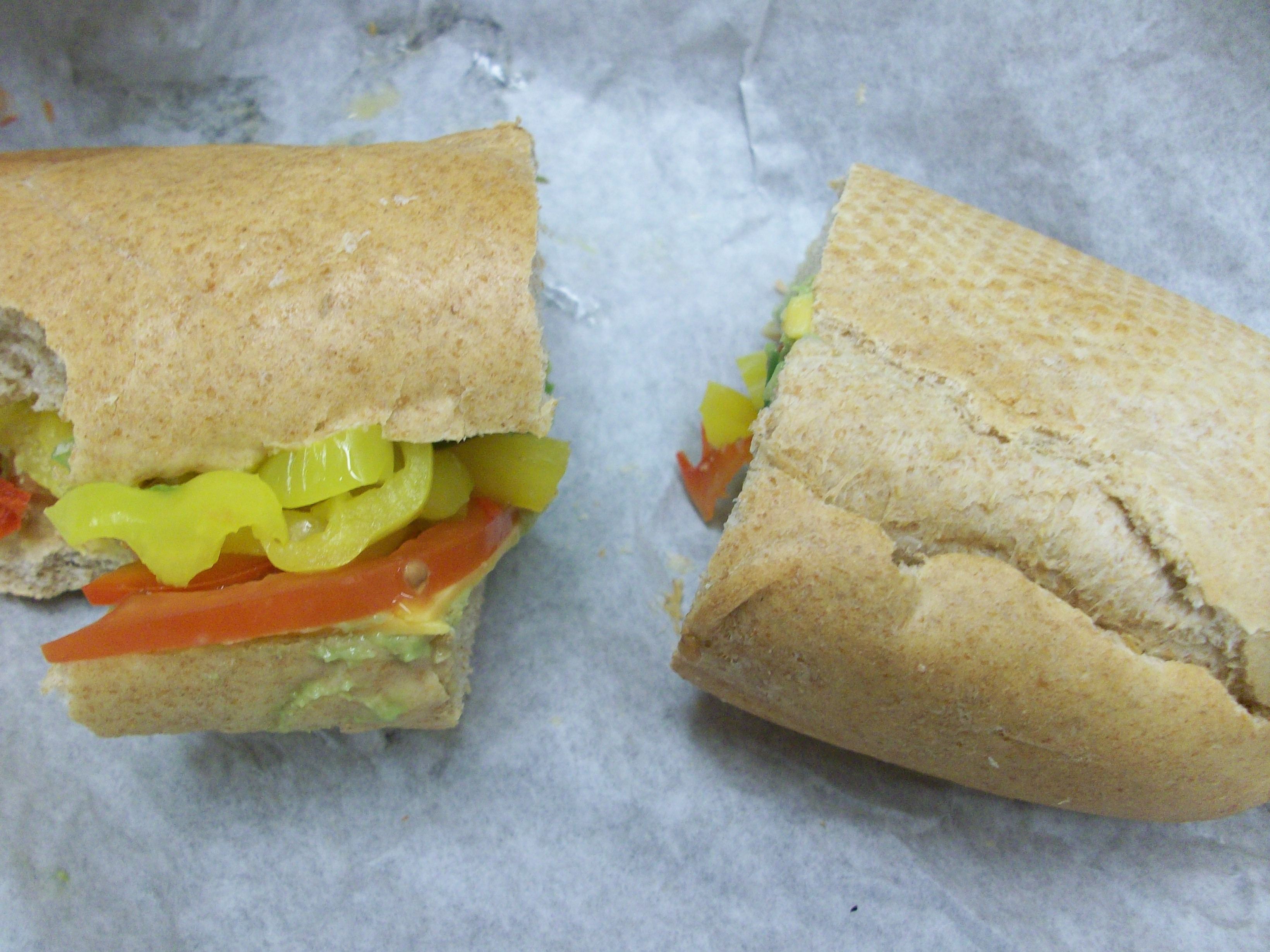 """6"""" wheat, bell peppers, tomato, guacamole, 1 slice cheddar cheese"""
