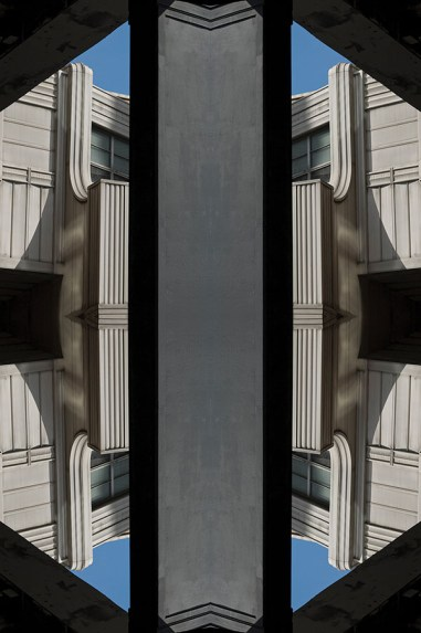 Computer altered mirror image abstract of decorative Art Deco building exterior. Two or more layers or generations were used to enhance, alter, manipulate the image, creating an abstract surrealistic mirrored symmetry.