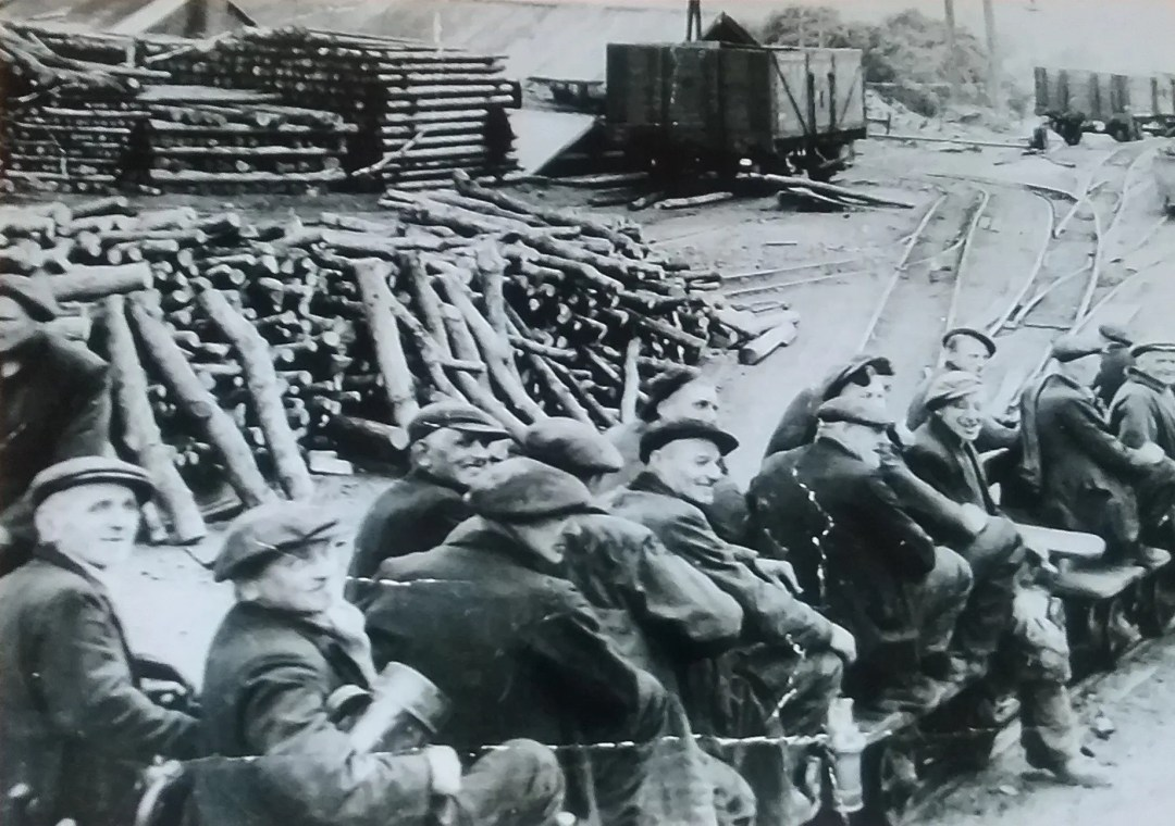 Don Davies took this photo of miners of the Llandebie Colliery readying for the SPAKE to take them underground for the start of the Afternoon shift.  Don's father, Harold Davies can be seen SMILING in the photo.