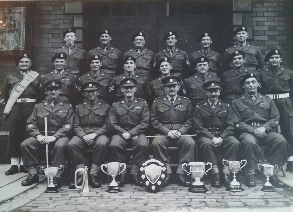 4th Battalion The Welsh Regiment. 24yr old Don Davies 1st left top row