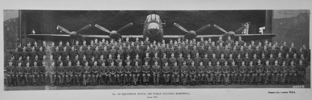 Photograph of RAF No. 150 Squadron standing in front of a Lancaster bomber.