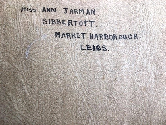 Inside cover of Adelaide Martin's World War Two autograph book.