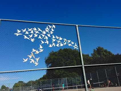 pretty paper and plastic doves make one huge dove, in Trinity-Bellwoods Park
