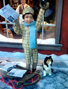 Newsboy and sweet tiny sheltie (in Hudson's Bay Christmas window