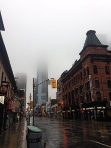Foggy mid-town, looking up Yonge Street towards Bloor (that's the new tower, obscured by mist)
