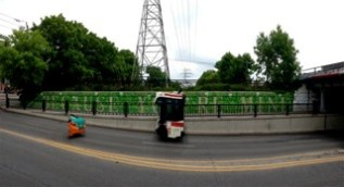 Because You're Mine... in a very funny panorama shot. Yes, that's a taxi and a bus!