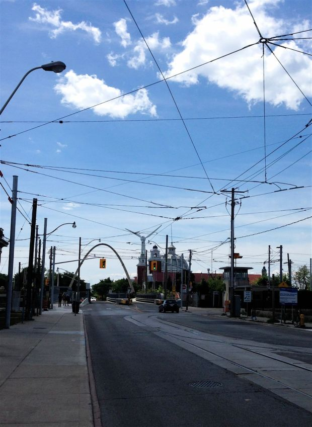As we walk north on Dufferin, we look south towards the Dufferin Arch at the CNE, and the turbine. And all those streetcar lines. What an interesting city!