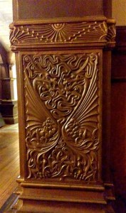 A copper dragon-embossed pillar decoration.
