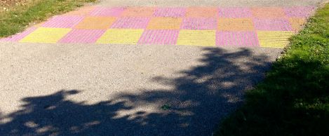 At one junction along the trail, someone has added colourful sidewalk details like a crosswalk...