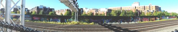 On the way there, we took a quick look at the long Liberty/railroad track mural wall.