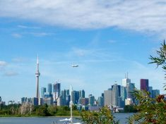 Meanwhile, city-side, the Goodyear Blimp is cruising near the CN Tower.