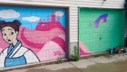 new lane garage door murals (all about pollinators) Garrison Creek Park laneway - Anya Mielniczek was painting on the right (note how the left colours continue onto the right door... )