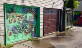 new lane garage door murals (all about pollinators) Garrison Creek Park laneway - just getting started, a bat painting, by Wales
