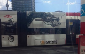 CN Tower and terrific Sapporo beer dragon on a new streetcar - gorgeous!