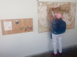 Helena marks the World in Ten Blocks map (where you or parents or grandparents originated)