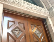 Beautiful carved doors and stone door frame, on Wellington Street West.
