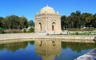 Samanide mausoleum in Bukhara mirrors in a pond
