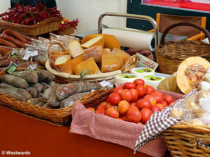 Cheese. Salami and tomatoes at a farmers market