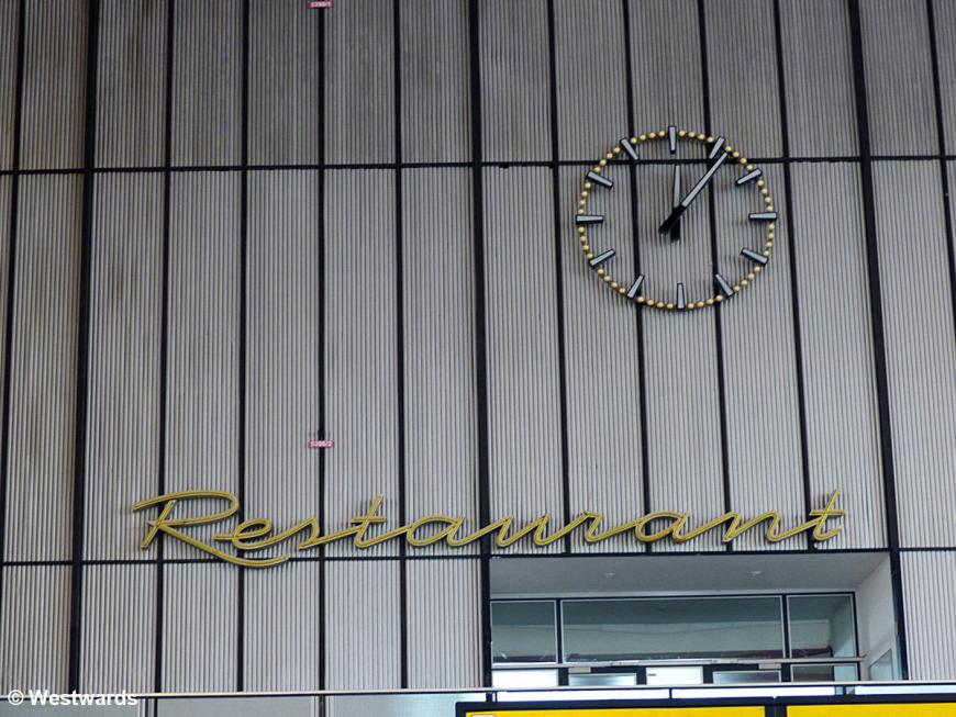 Clock and restaurant sign in the old Tempelhof Airport