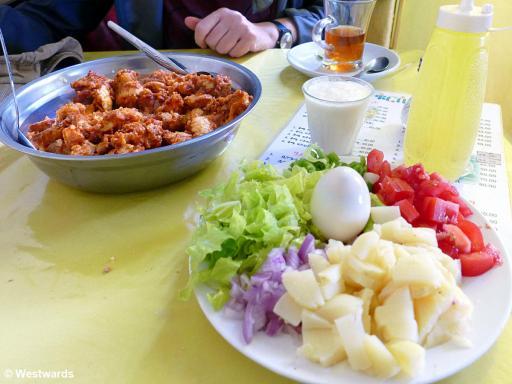 Eritrean Fattah with potatoes, bread, salad and egg