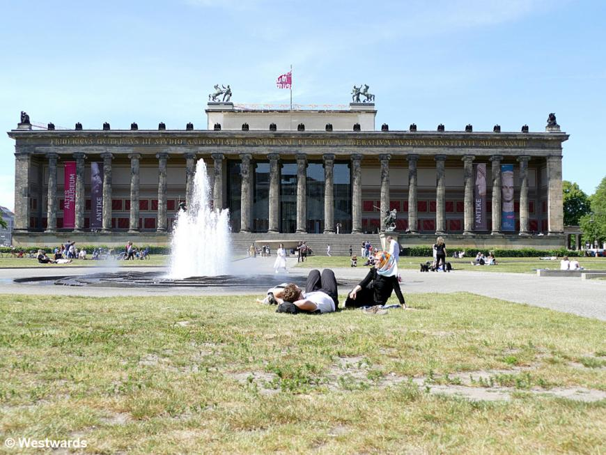 People relaxing on the lawn in front of the Altes Museum in Berlin