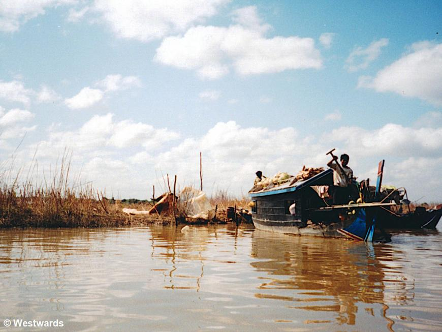Cambodia locals travelling by boat between Siem Reap and Battambang