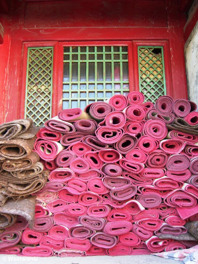 Prayer mats piled at Tayuan Temple