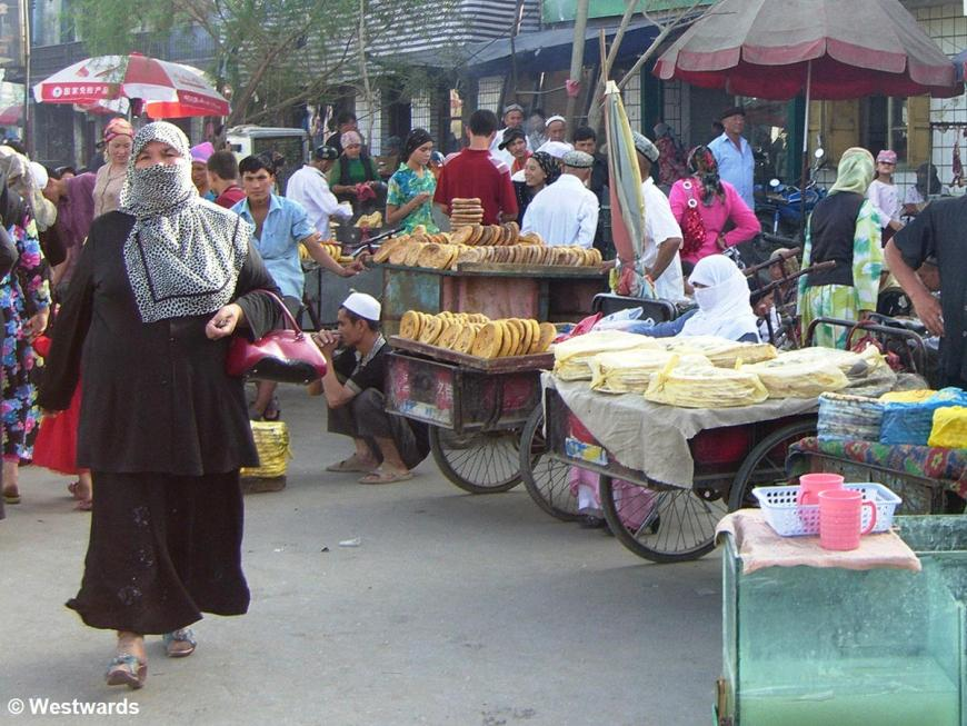 Uighurs on the market in Hotan