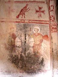 Scarred Christian frescoes in a church in Goereme Open Air Museum