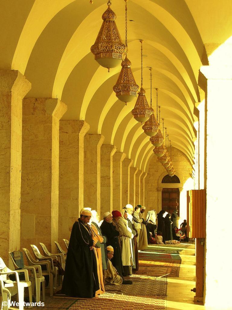 Praying men in the Umayyad Mosque in Aleppo