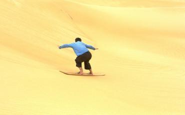 Isa sandboarding at the Siwa desert