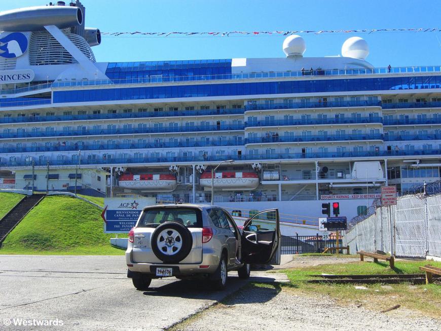 Street crossing the Gatun Locks of the Panama Canal, with a huge cruiseship across the street