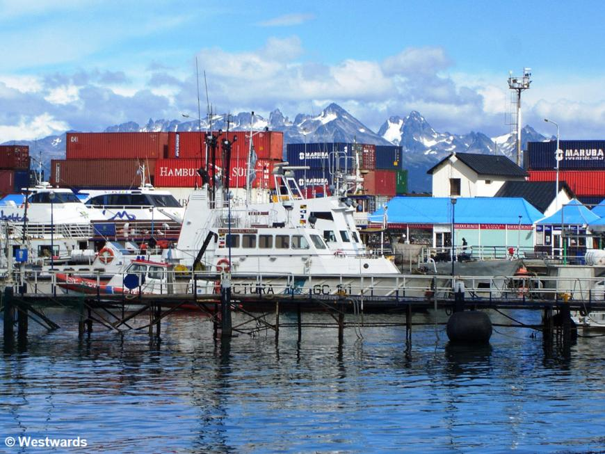Ushuaia harbour with snowy mountains and stacked containers