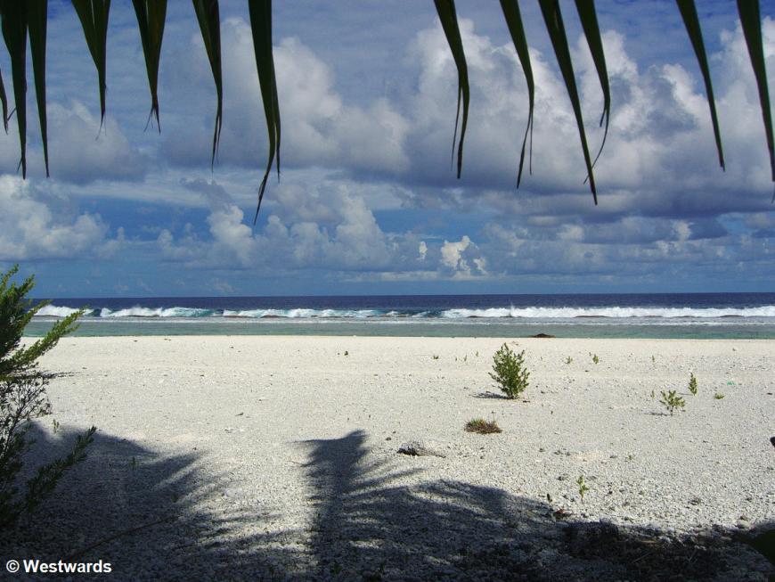 Beach and sea at Maupiti motu Auira