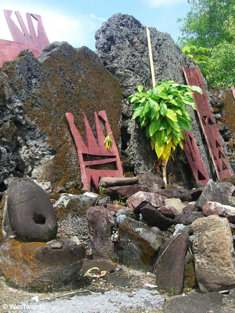 Stones and wooden boards at Marae Taputapuatea, a Polynesian ritual place on Raiatea
