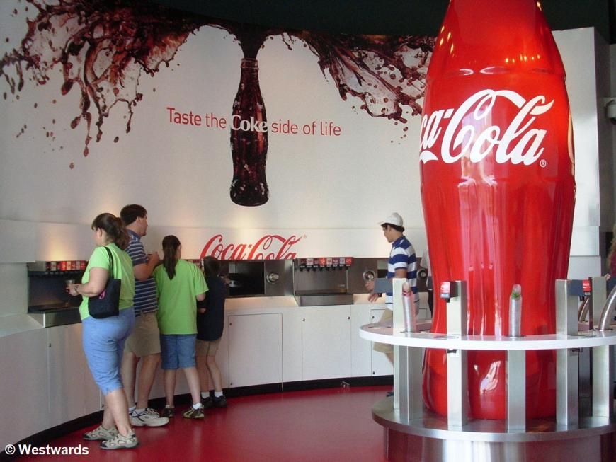 visitors in the tasting area of Coca Cola World in Atlanta