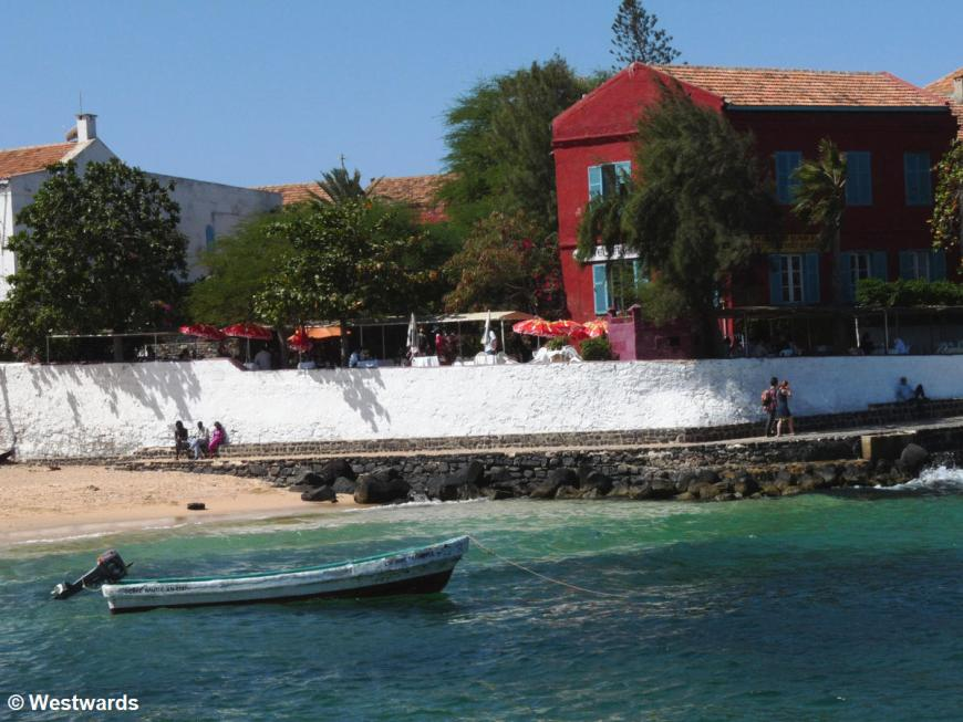 waterfront with boat and outdoor cafe on the Ile de Goree waterfront