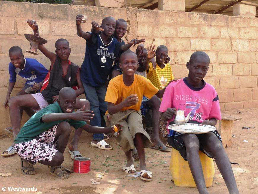 children posing with tea in Matam