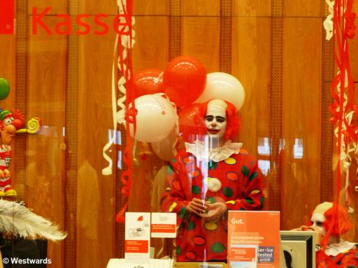 Clown in a branch bank during Cologne Carnival