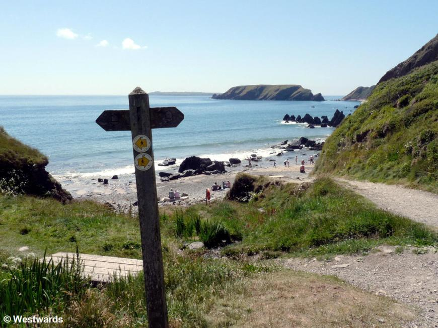 Pembrokeshire coastal path signage with beach