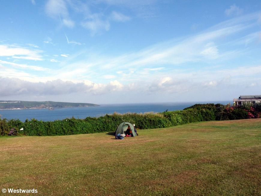 tent with Pembrokeshire coast in the background