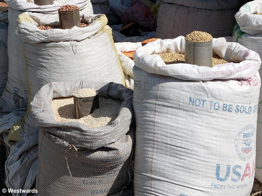 Grain bags in a market stall, marked USAID, not to be sold