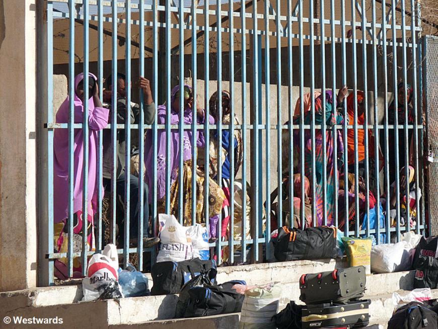 women behind prison bars in the desert