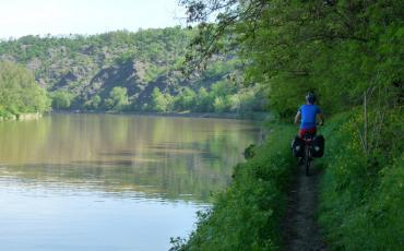 Cyclist at the river Moldau