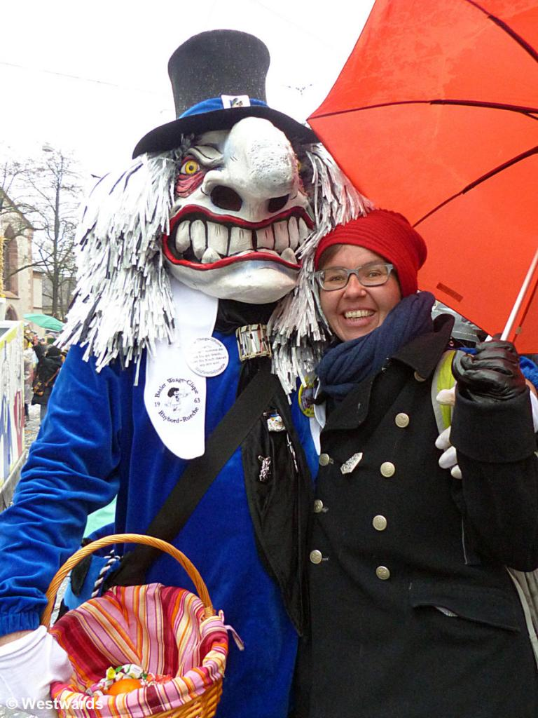Natascha with a masked figure in the Basel Cortege