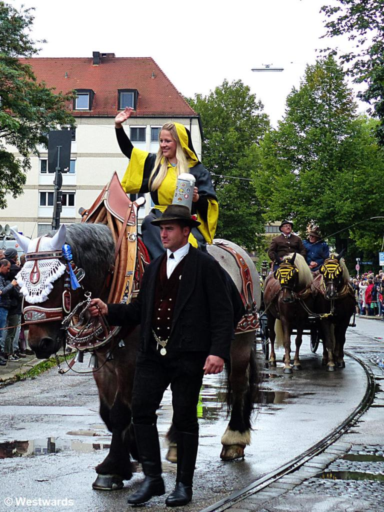 """Muenchner Kindl (the """"child of Munich"""" mascot) at the Wiesneinzug procession"""